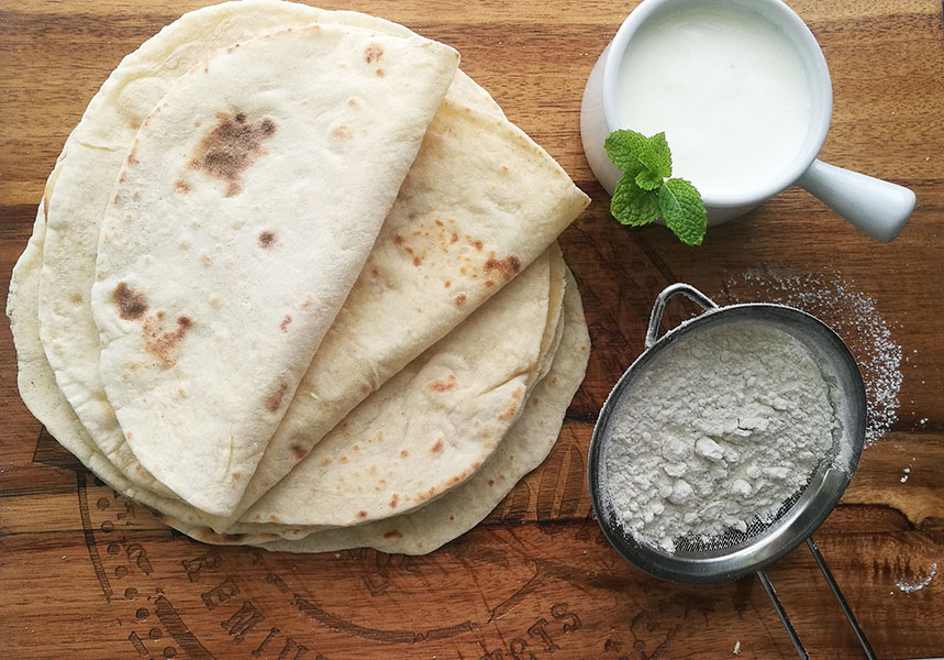 When you need a quick and easy side dish for dinner, this 3 ingredient yogurt flatbread recipe comes to the rescue. Made without yeast, yet so soft and pliable these are perfect as a sandwich wrap, or quick pizza base, or naan alternative.