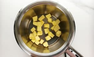 Start by heating the butter in a heavy-based pot on very low heat.