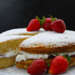 My recipe for Victoria Sponge Cake is the perfect treat for any occasion. Sandwiched with whipped cream and jam, topped with a dusting of powdered sugar, it is elegant simplicity at its best. This version has all the amazing taste of the classic Victoria sponge, but it's made without eggs and butter.