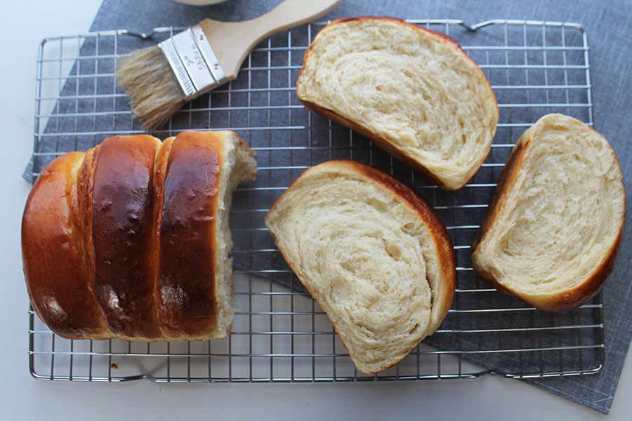 Fill your home with the delicious aroma of my bakery-style Condensed Milk Bread. Super soft, fluffy, and light makes an impressive bake or enjoyed as an everyday bread recipe.